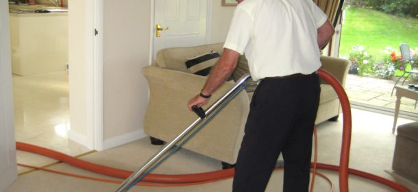A.T. Brown & Son cleaning carpet in the living room