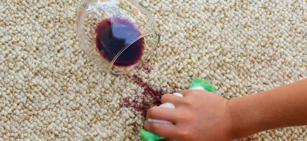 Red wine spilt on carpet being cleaned